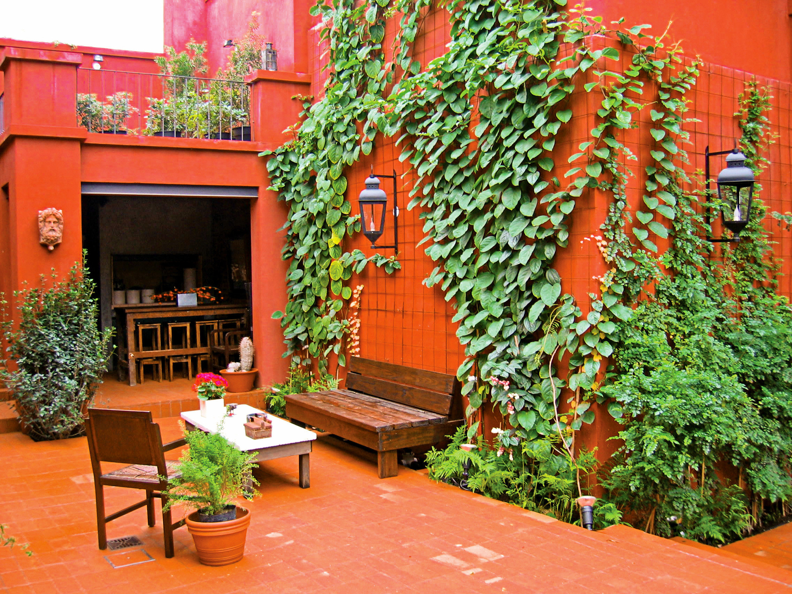 Architecture Dining Drink Eat Grounds Outdoors orange flower red floristry Courtyard backyard Garden yard outdoor structure plant stone