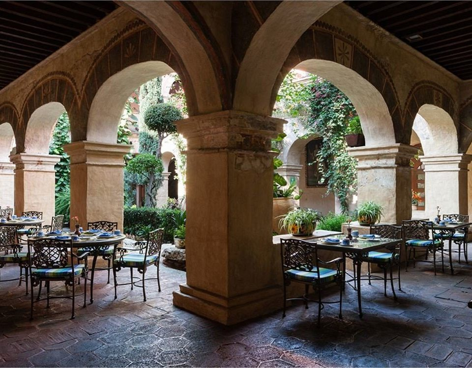 Courtyard Dining Drink Eat Garden Outdoors Patio Terrace building chair Architecture arch palace ancient history place of worship chapel hacienda court colonnade
