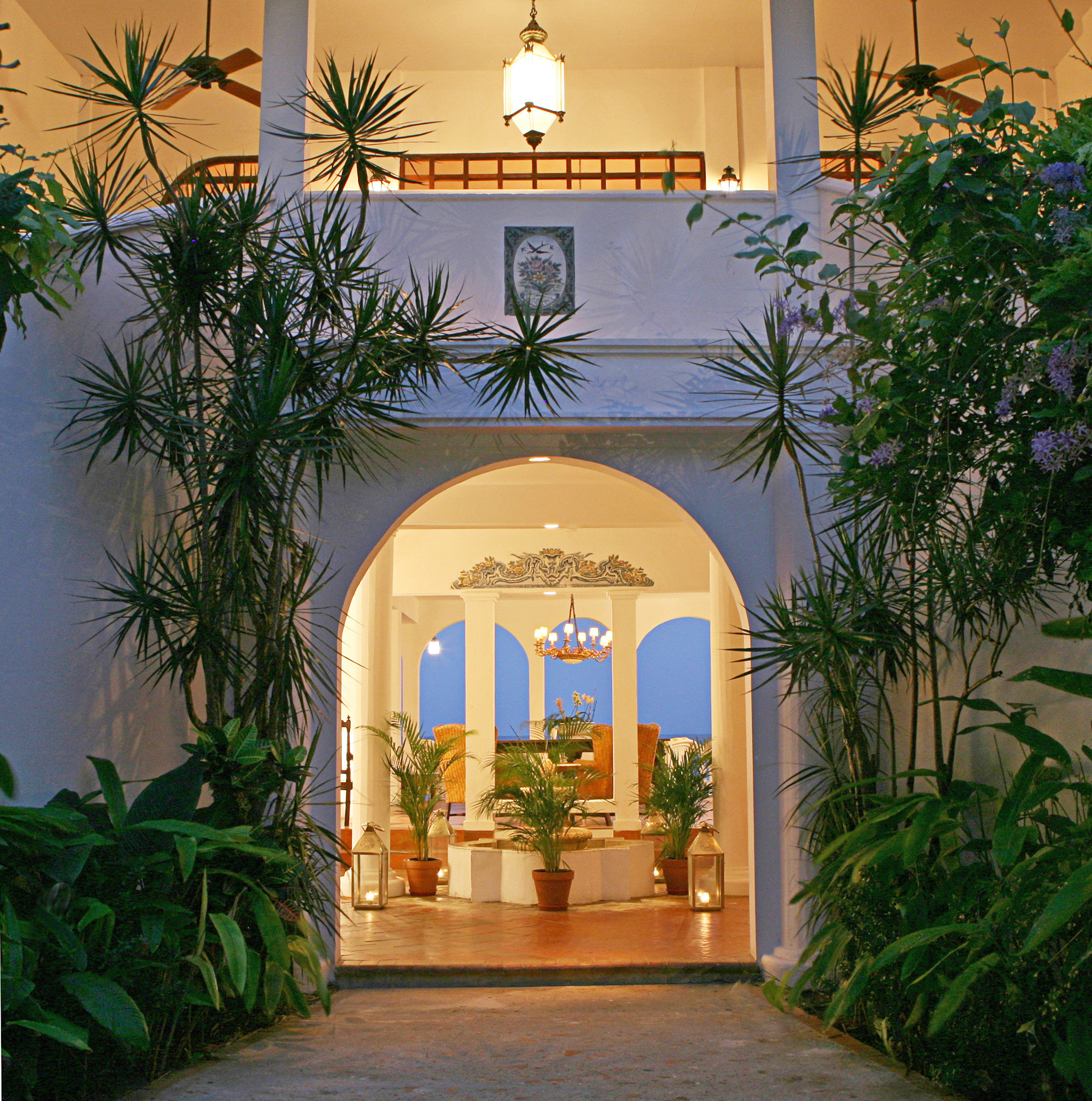 Luxury Resort tree plant building property house Courtyard home Architecture arch hacienda Villa mansion palm bushes Garden altar colonnade