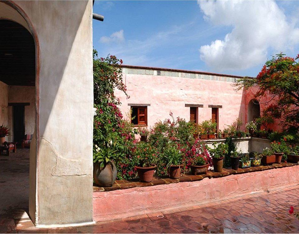 Garden Terrace building house neighbourhood Architecture sidewalk brick hacienda home Courtyard stone