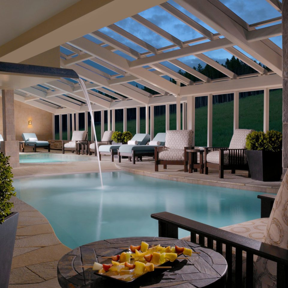 Lounge Patio Pool Rustic property swimming pool building Architecture Lobby home Resort condominium Courtyard colonnade