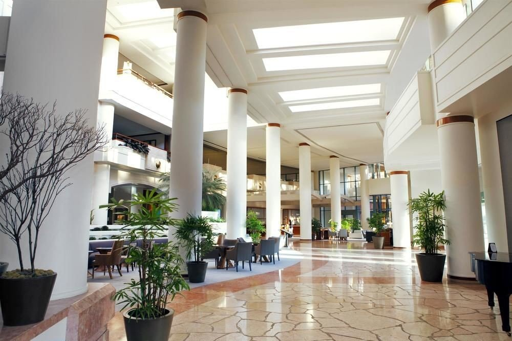 Lobby property building condominium Architecture Courtyard plaza home Resort headquarters mansion plant palace Villa