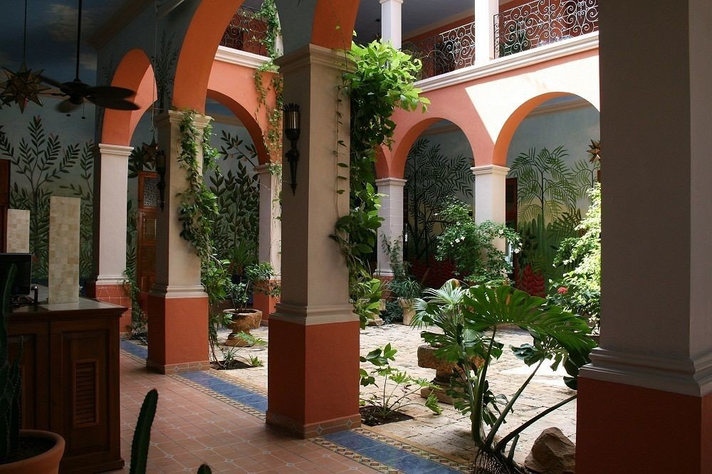 property building Courtyard house home hacienda Architecture plant Villa Lobby mansion arch porch colonnade