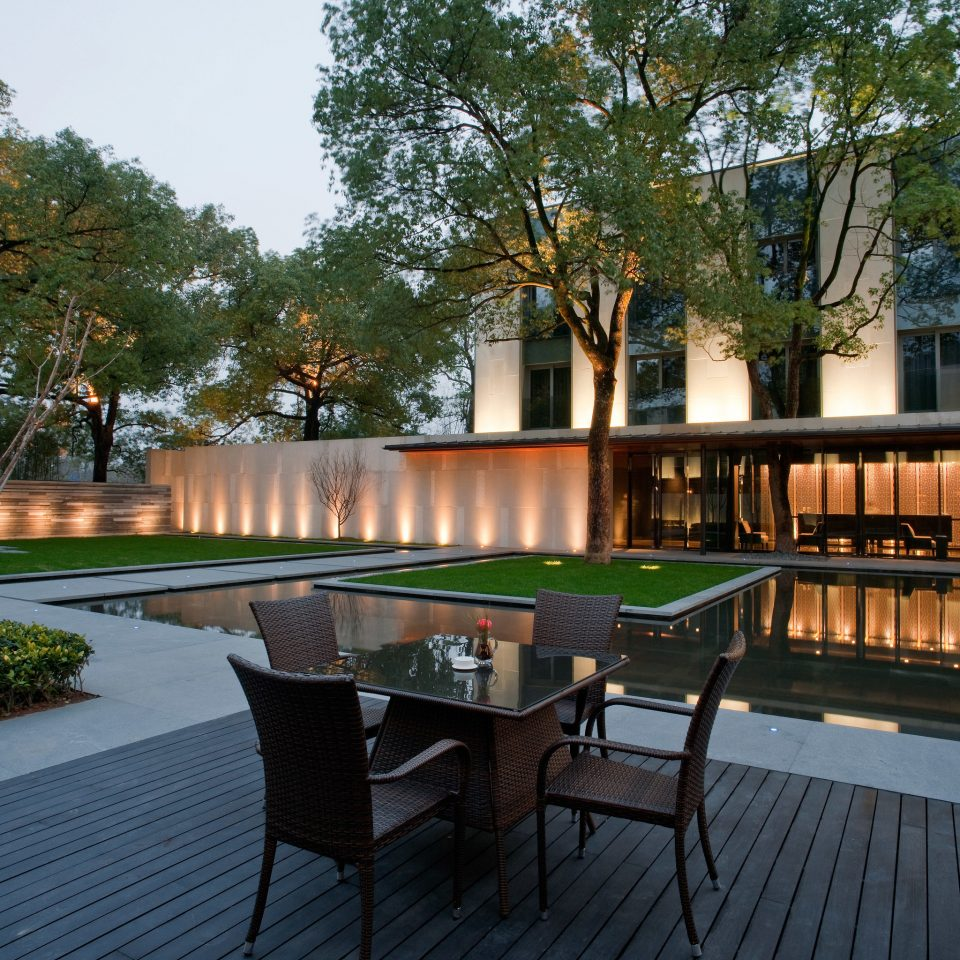tree property swimming pool Architecture plaza condominium reflecting pool home Resort Courtyard backyard outdoor structure Villa