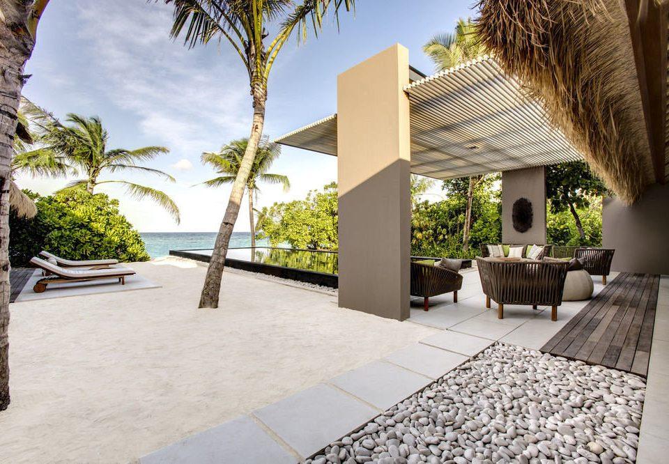 tree property condominium home Courtyard Villa Architecture Resort walkway mansion hacienda backyard stone