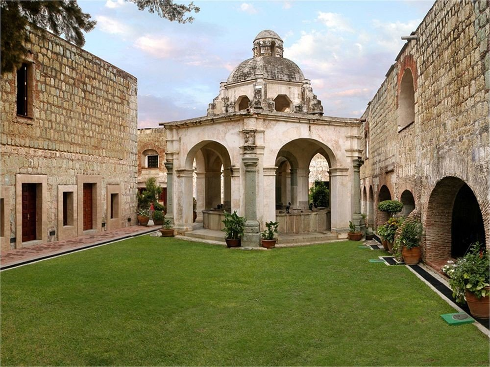 Courtyard Romantic Rustic grass building stone historic site brick Architecture old stately home monastery palace place of worship abbey ancient history spanish missions in california structure arch walkway colonnade