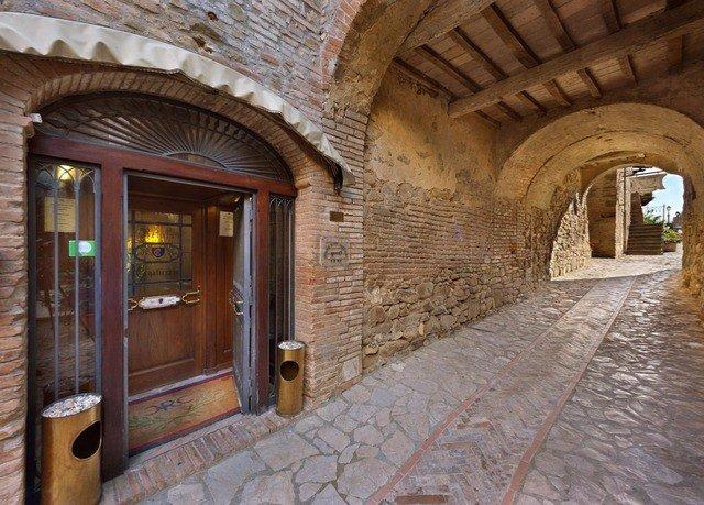 building property Architecture brick hacienda arch home stone Courtyard mansion Villa