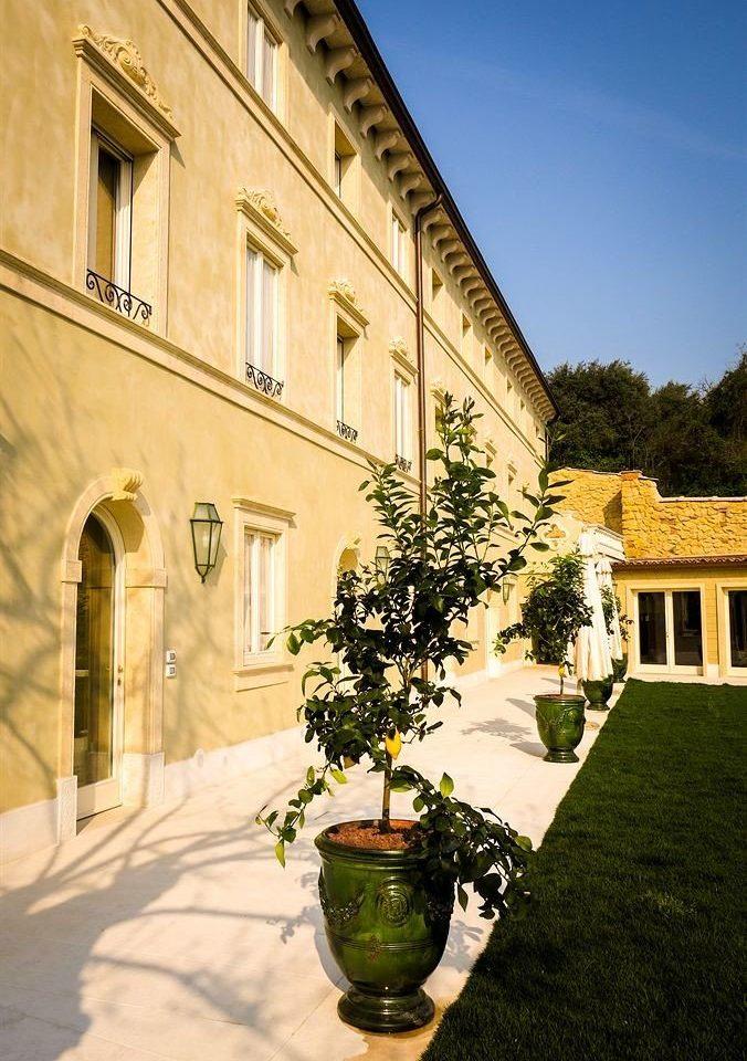building property house Courtyard Architecture home neighbourhood mansion palace Villa hacienda plant stone