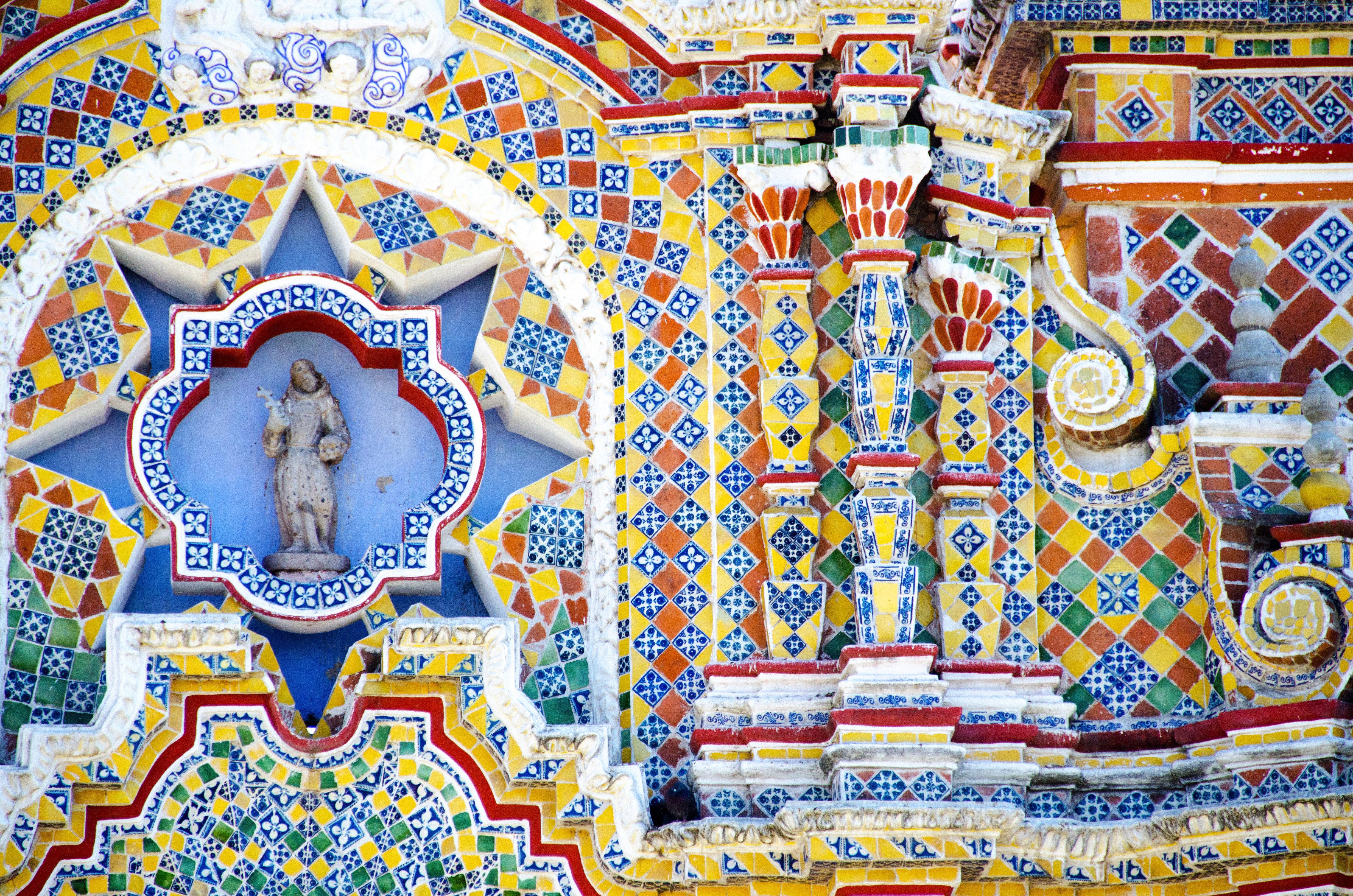 Architecture Cultural Historic Resort hindu temple colorful temple art mural place of worship amusement park amusement ride colored