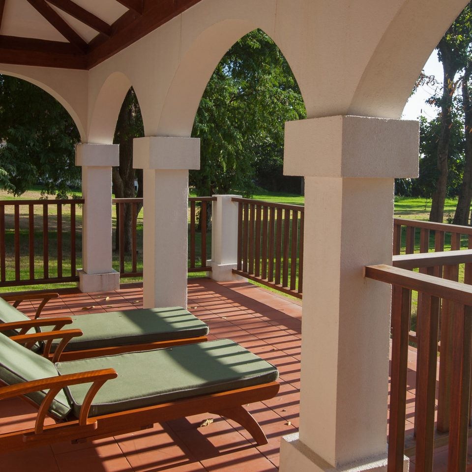 tree building chair porch property Architecture home outdoor structure stairs Villa mansion Deck colonnade