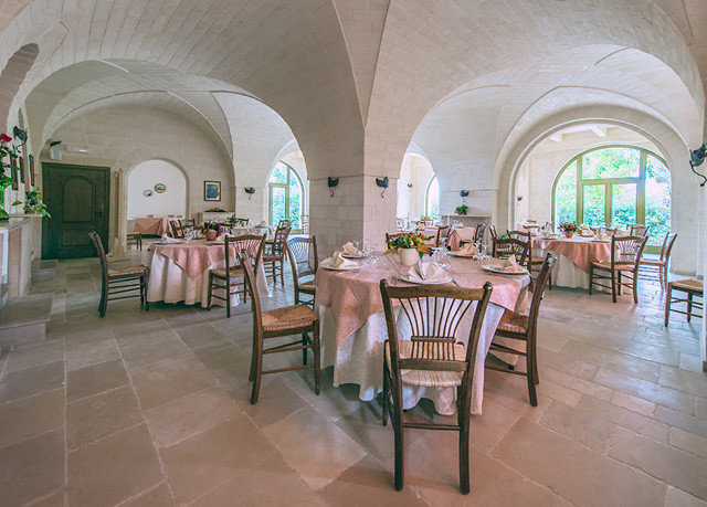 chair property Lobby building Dining Architecture restaurant palace mansion hacienda function hall Villa aisle Resort