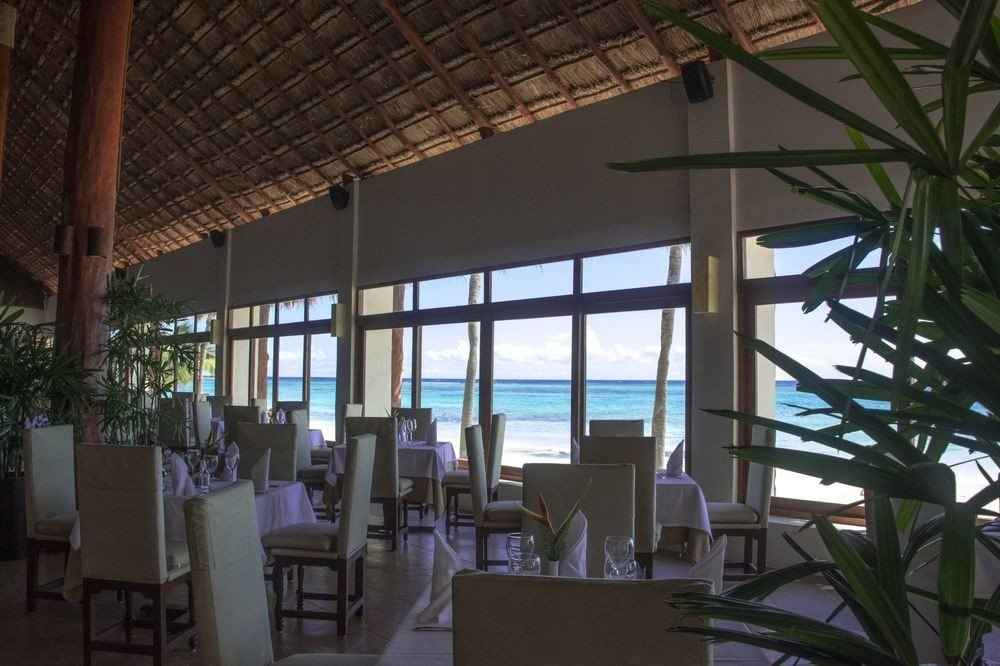 chair property Resort Dining Architecture condominium restaurant home Villa convention center dining table