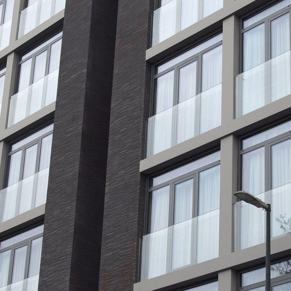 Elegant Exterior Modern building property Architecture tower block neighbourhood residential area condominium Downtown apartment building tall