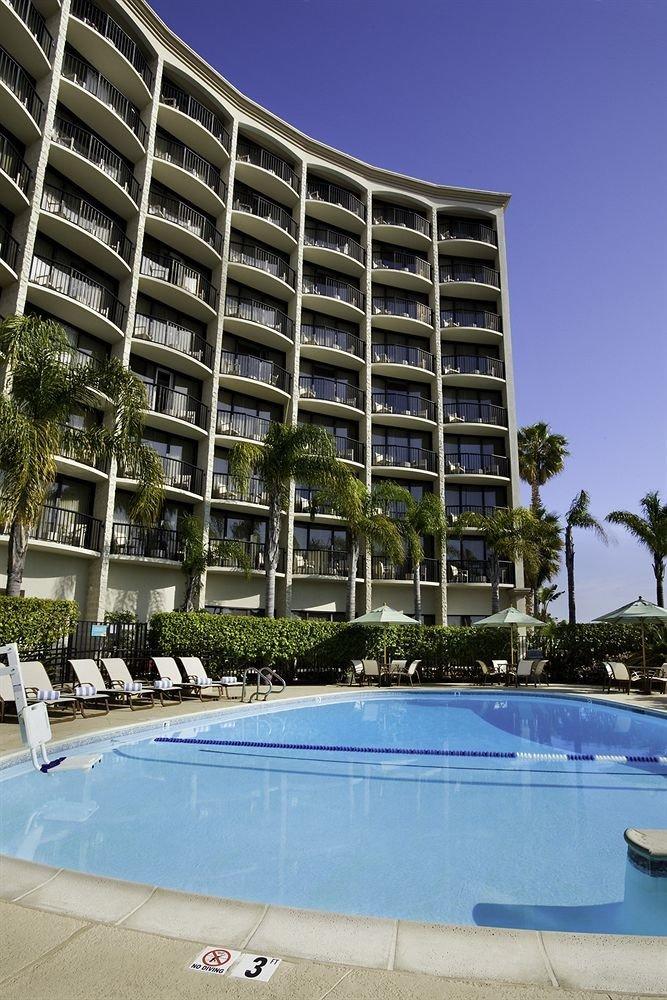 sky condominium swimming pool Architecture plaza residential area Downtown tower block Resort headquarters blue