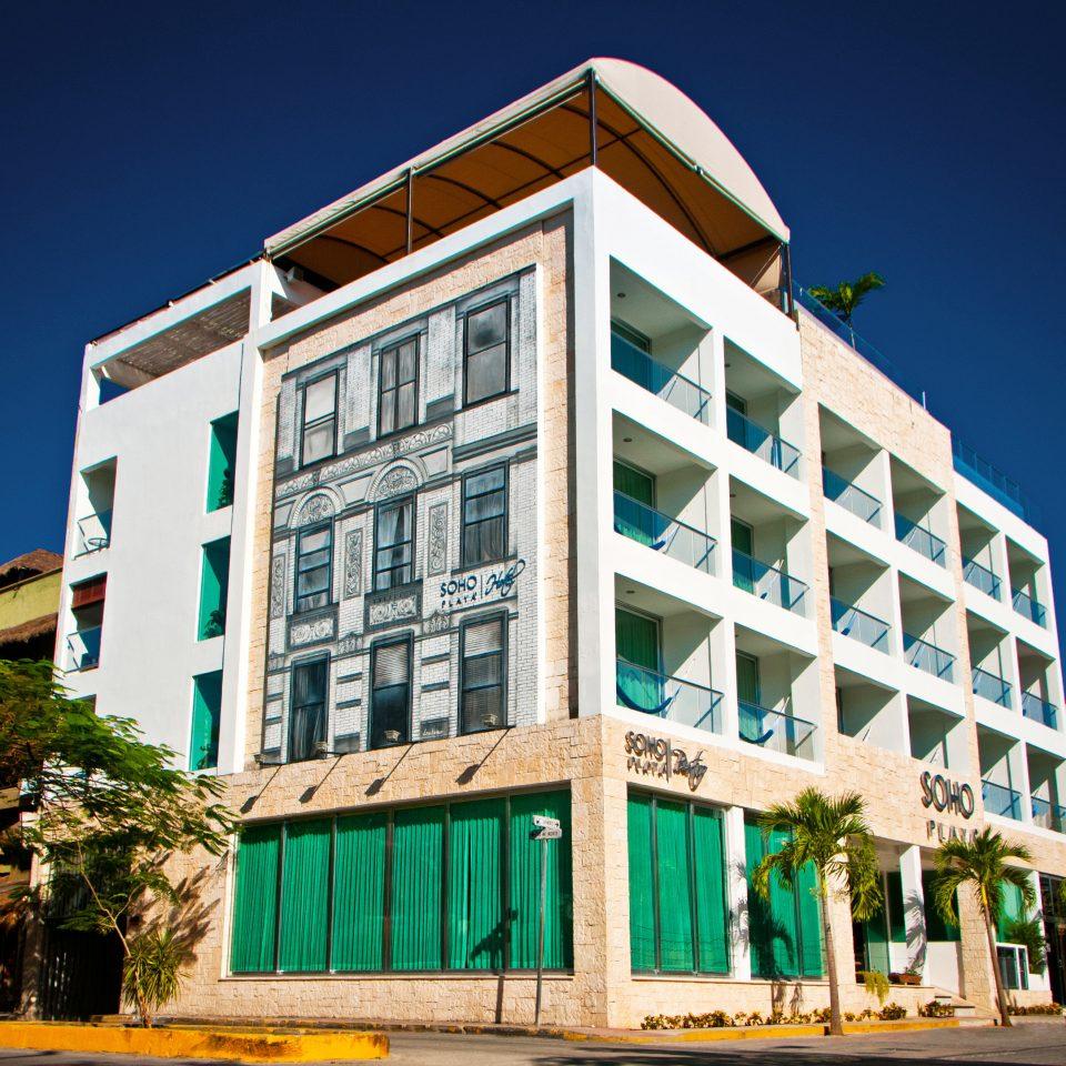 building tree condominium house landmark neighbourhood tower block residential area Architecture Downtown home plaza Resort roof
