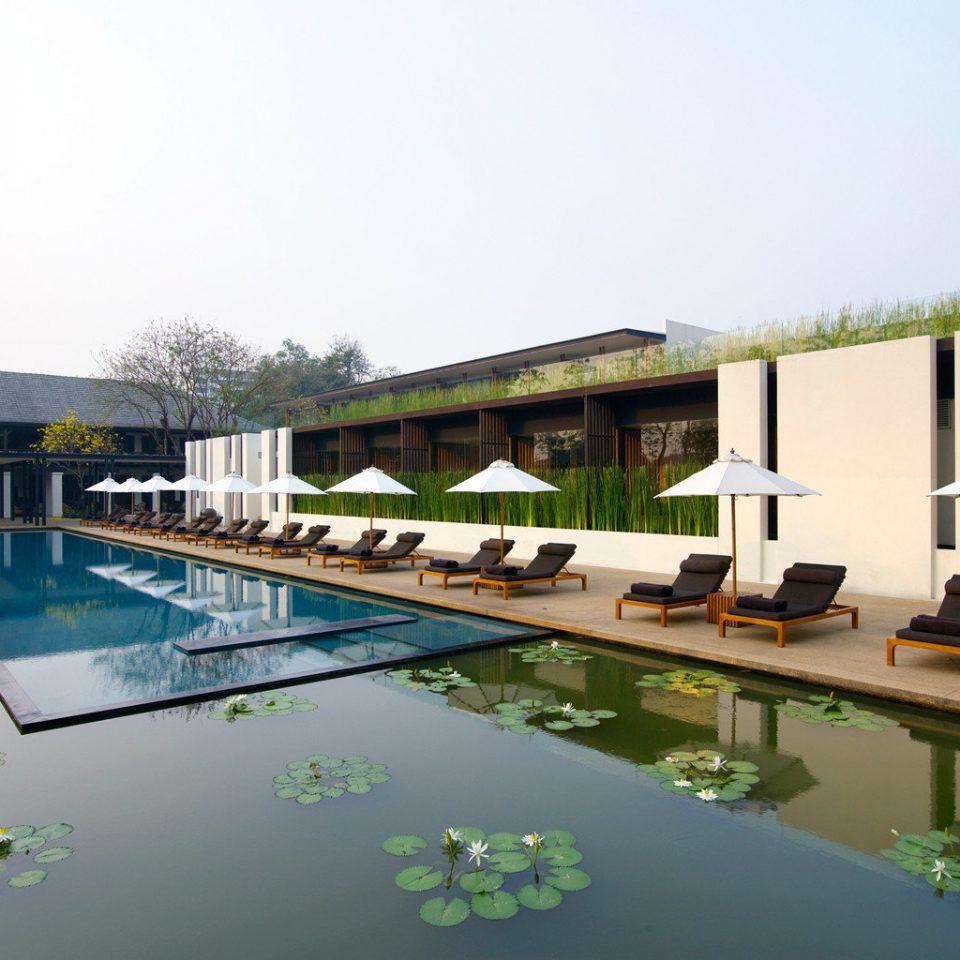 Elegant Hip Hotels Luxury Pool Romance Waterfront sky water swimming pool leisure property condominium Architecture reflecting pool Villa Resort
