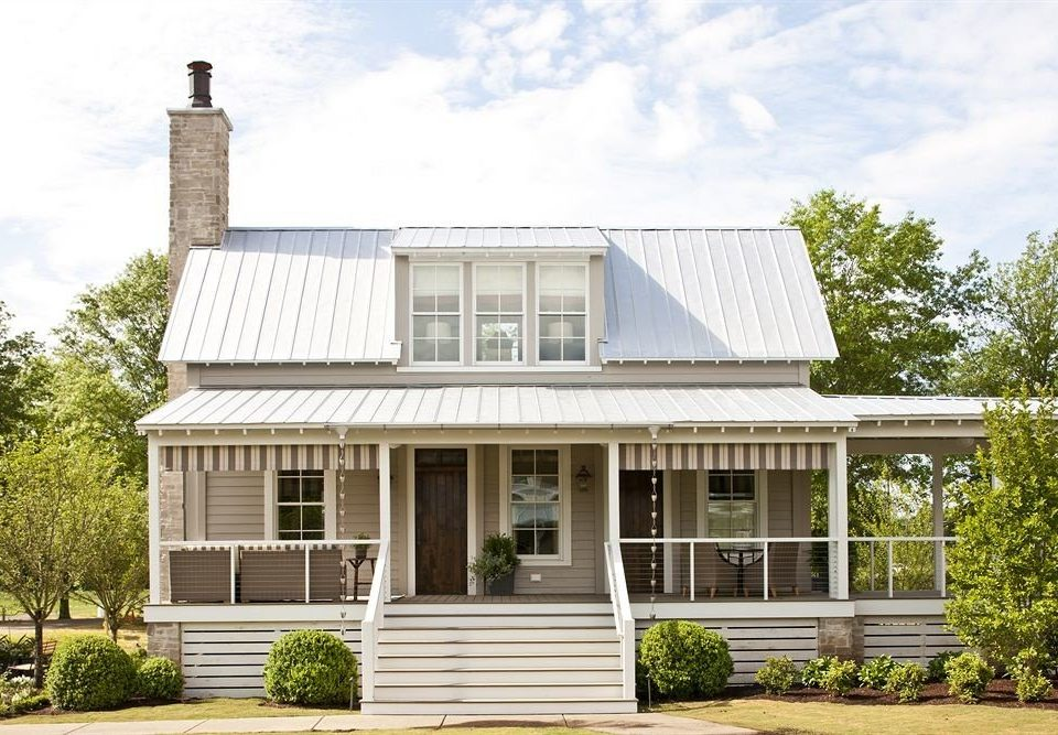 Exterior Inn building sky tree house property home siding residential area Architecture cottage old orangery roof farmhouse outdoor structure Garden stone bushes