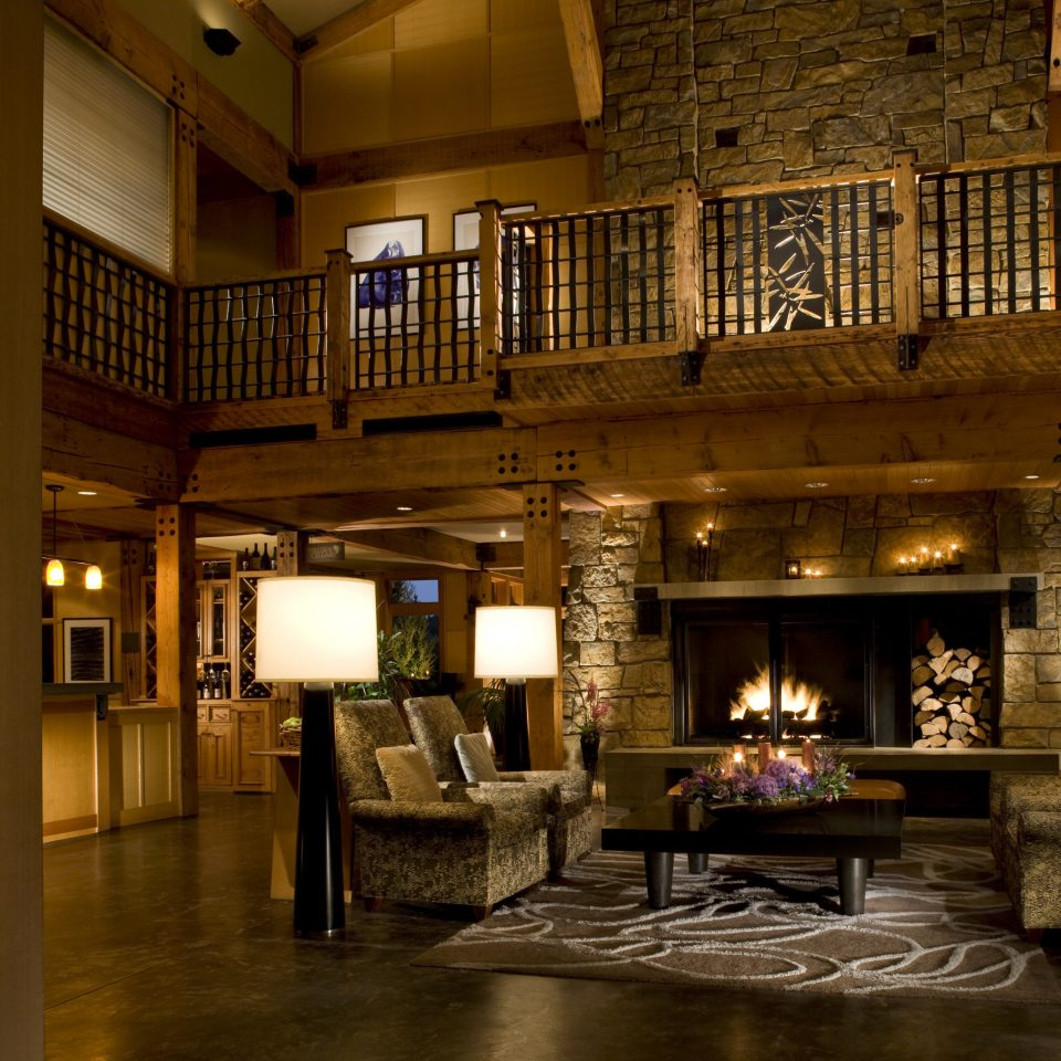 Fireplace Lobby Lodge Lounge Resort Romance Romantic Rustic house property home building living room Architecture mansion lighting cottage night farmhouse