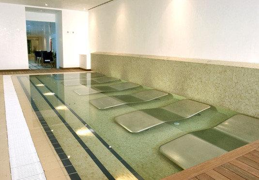 property swimming pool flooring Architecture daylighting lighting wooden Lobby condominium