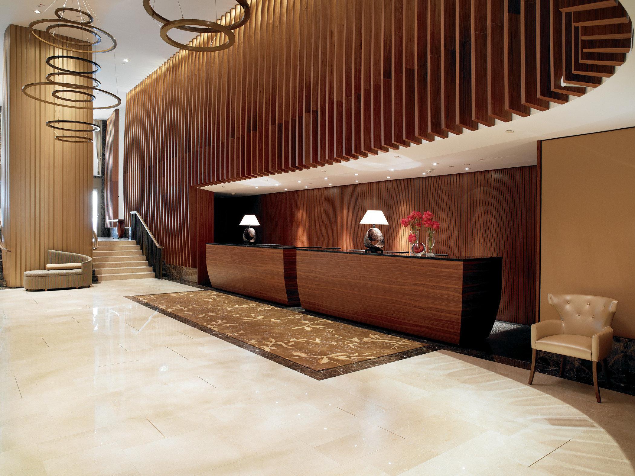 Lobby flooring Architecture hardwood wood flooring laminate flooring stairs interior designer hall