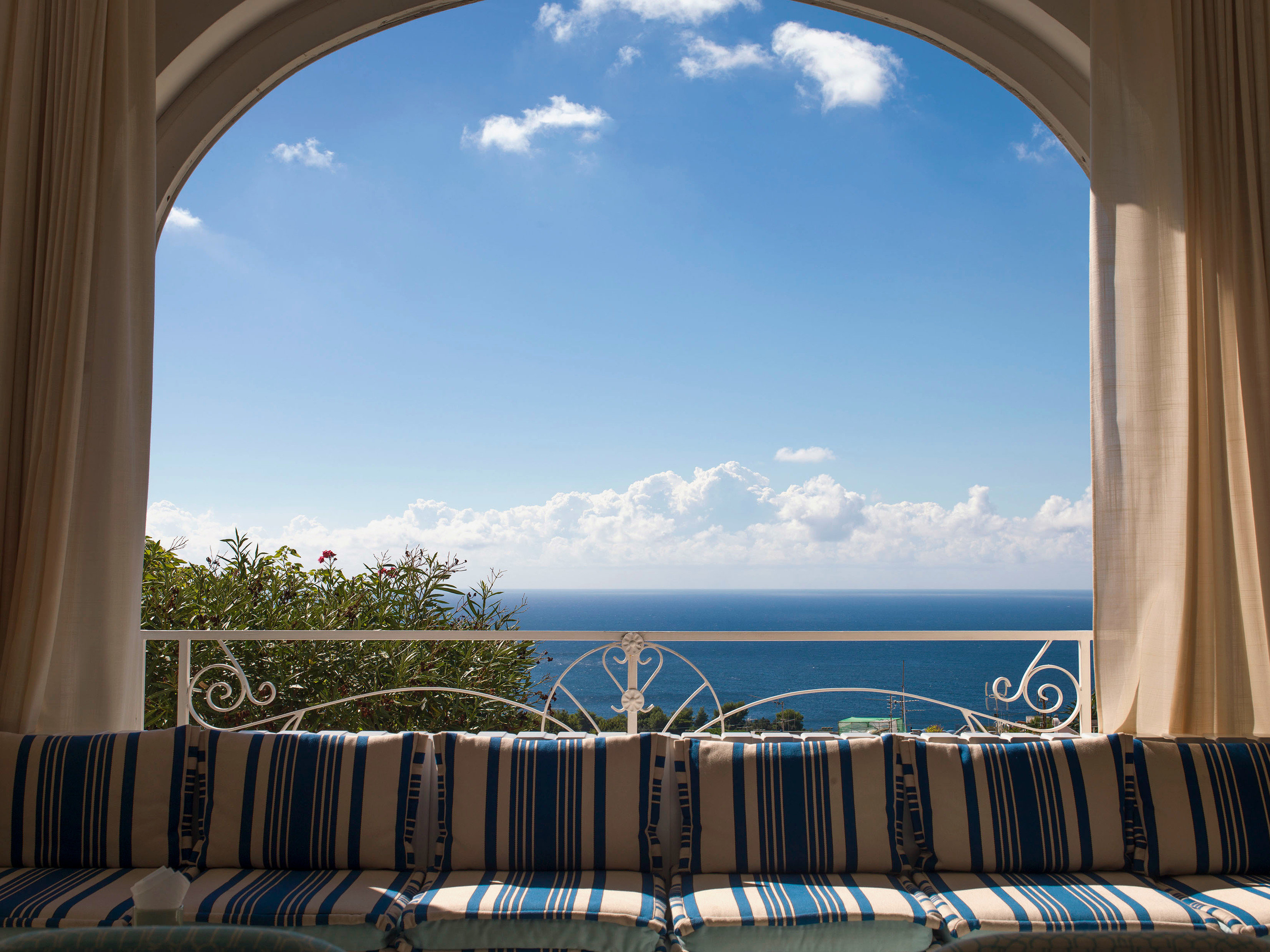 sky building blue arch property Architecture home Ocean Resort Villa overlooking mansion clouds colonnade day