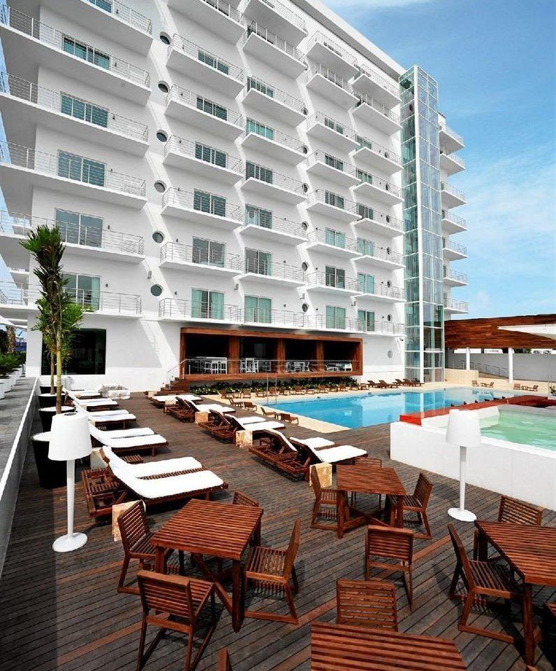 chair condominium property wooden Architecture plaza home Resort headquarters apartment building