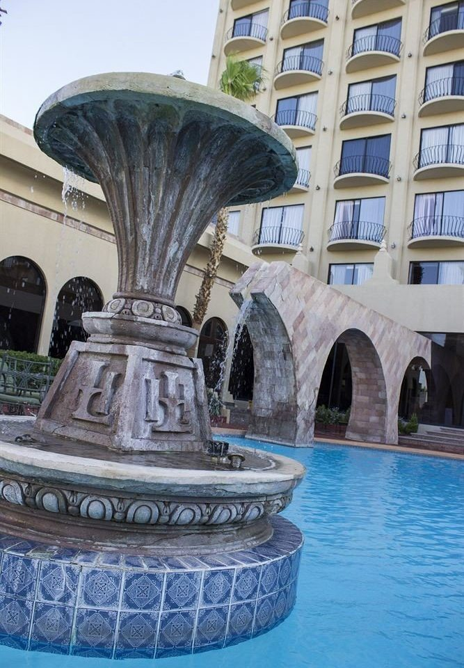 fountain landmark water building water feature Architecture plaza swimming pool palace stone arch Resort colonnade