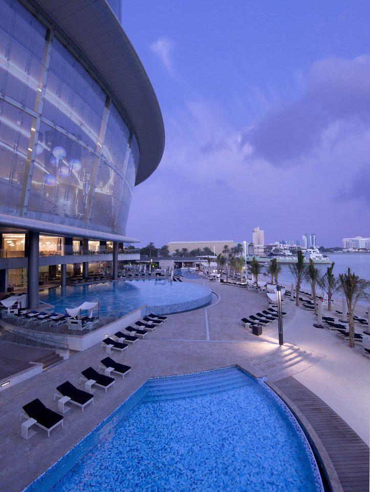 sky blue structure landmark sport venue Architecture marina swimming pool stadium cityscape dock evening Resort Sea vehicle