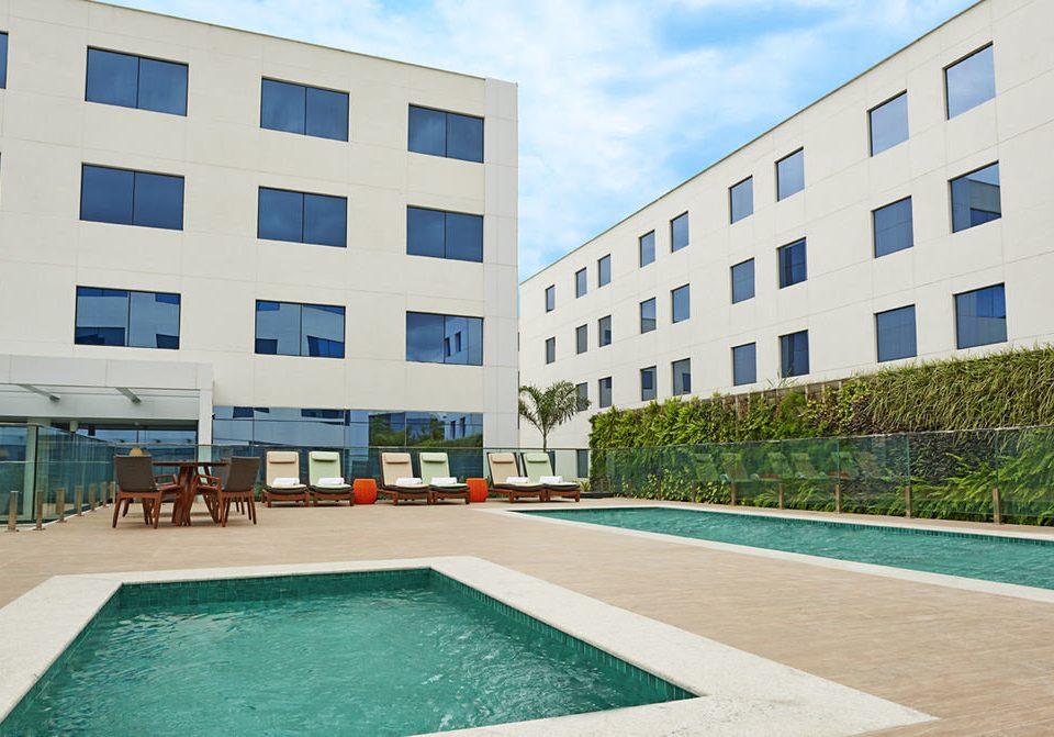 building property condominium swimming pool leisure centre Architecture plaza Sport headquarters Resort