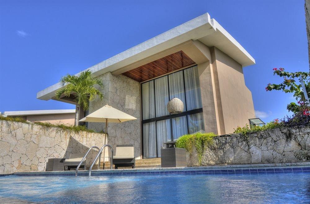 building sky property house Architecture Villa home mansion stone concrete Resort cement