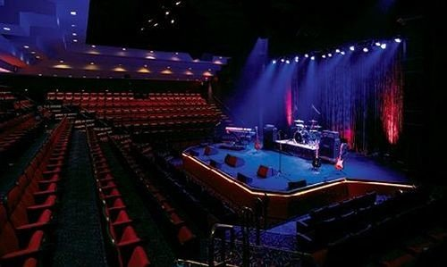 rock concert stage auditorium nightclub theatre audience music venue lit musical theatre arena dark