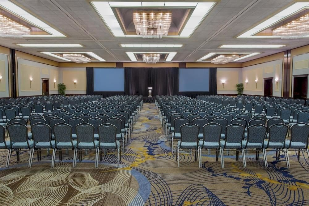 chair auditorium structure conference hall function hall sport venue convention center ballroom banquet convention meeting arena stadium empty lined