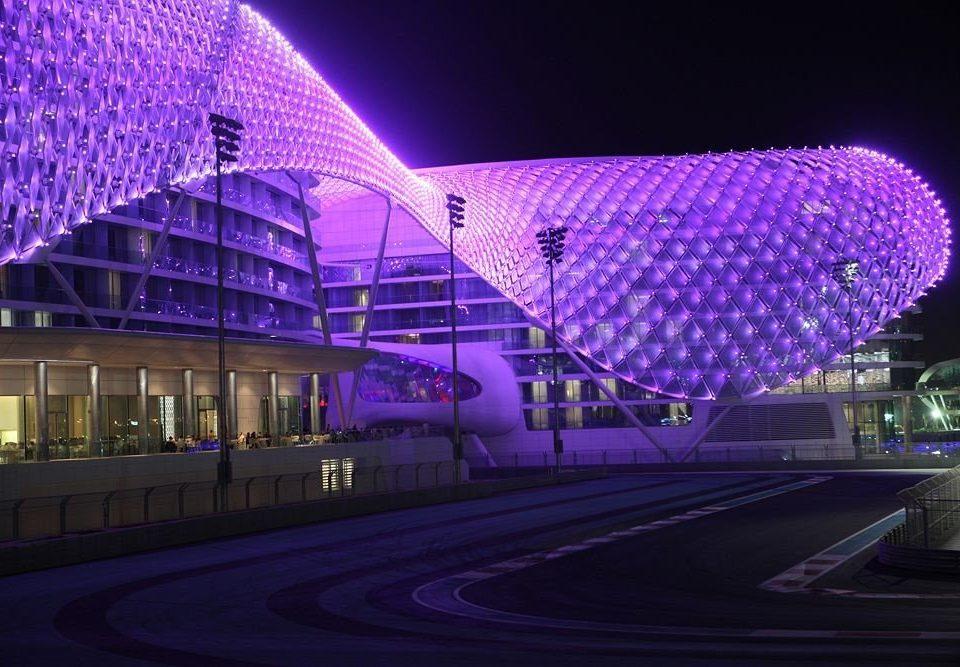 night metropolitan area light lighting stadium purple shape theatre cityscape convention center arena dome