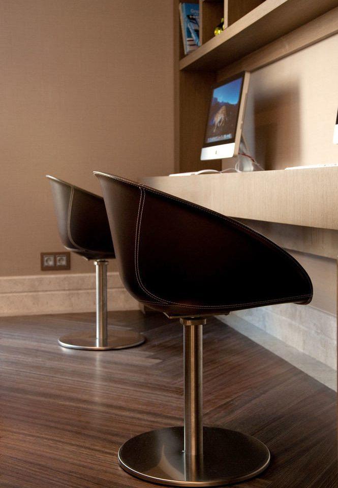 chair wooden flooring desk armrest