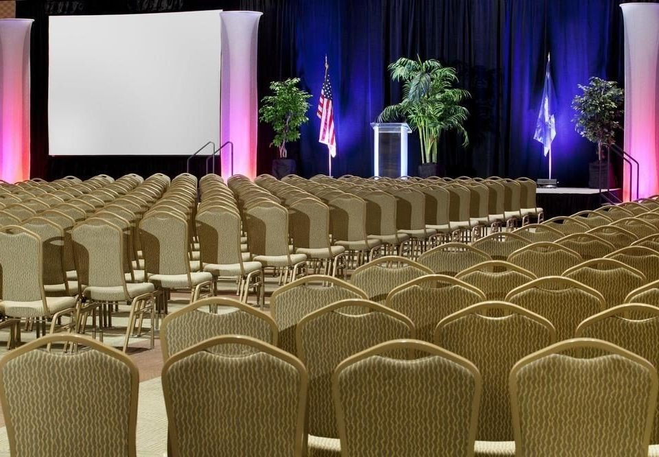 chair function hall auditorium stage banquet ballroom convention center arranged conference room