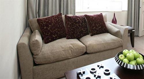 sofa living room chair couch seat bed sheet flooring studio couch loveseat colored arranged