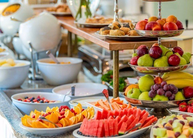 food plate breakfast counter bowl brunch fruit vegetable lunch buffet various full fresh arranged