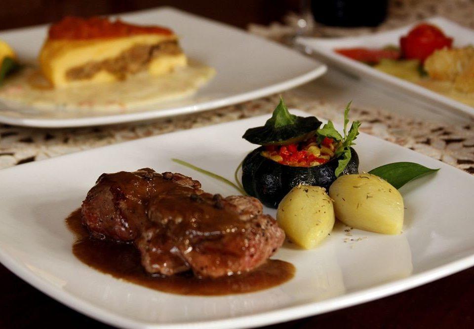 plate food meat restaurant dinner cuisine lunch steak white brunch supper breakfast hors d oeuvre full breakfast arranged piece de resistance
