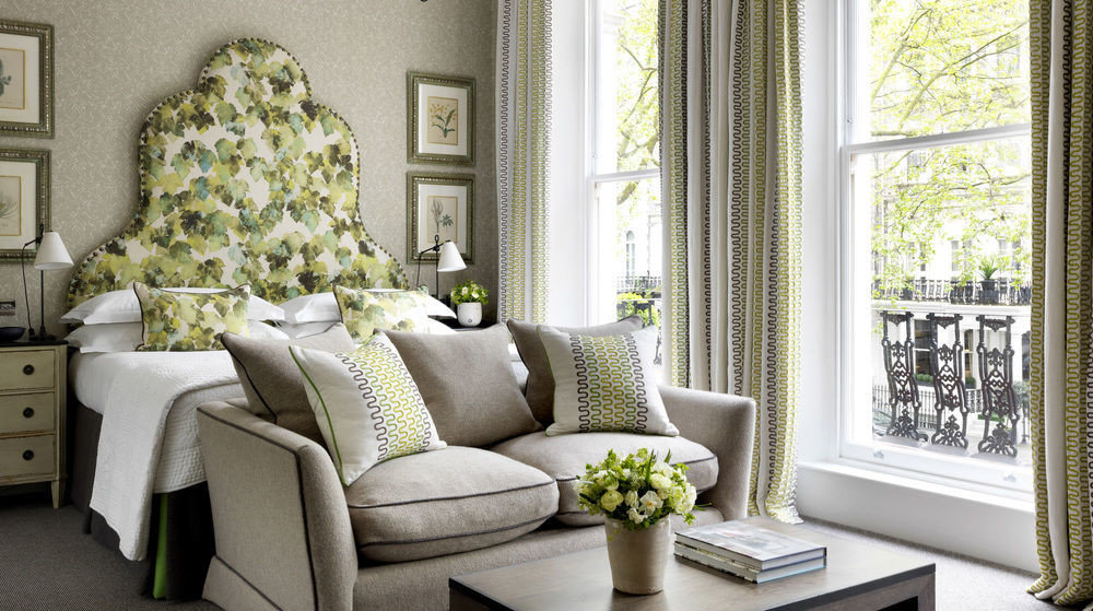 living room property green home porch curtain cottage window treatment arranged
