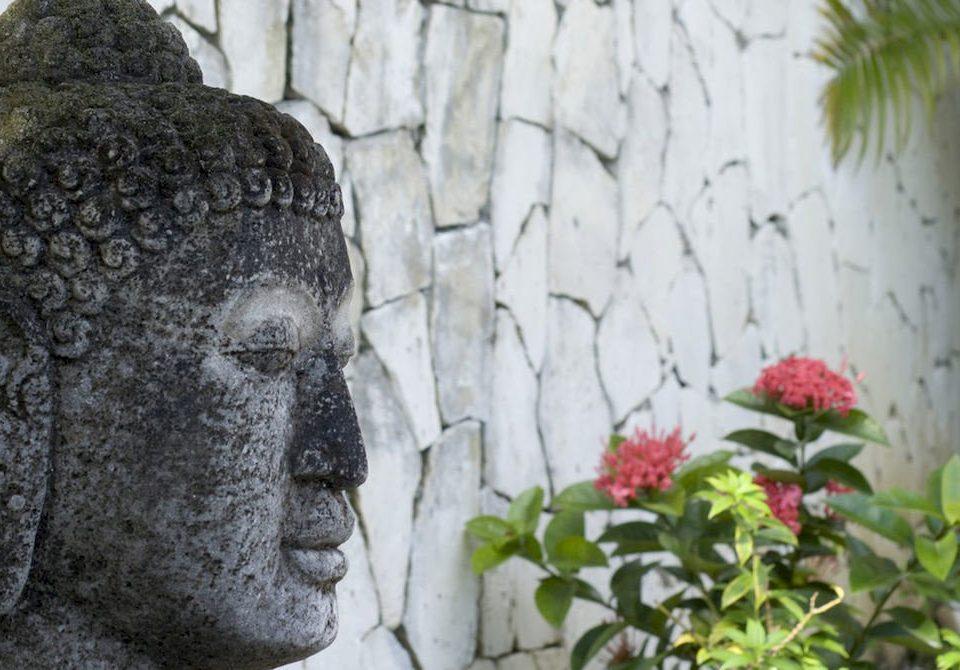 building statue art plant flower sculpture monument carving temple old stone building material