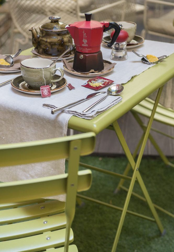 color chair green art set dining table cluttered