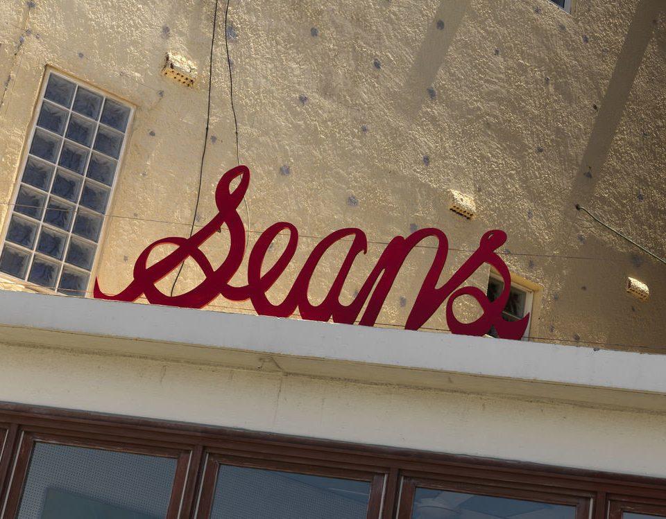 color red art sign shape restaurant signage
