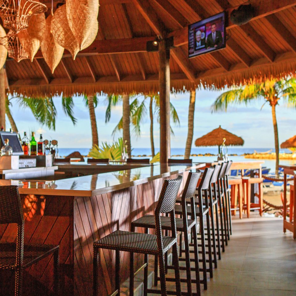 Aruba Bar Beachfront Budget caribbean Dining Drink Eat Hotels Party chair Resort restaurant wooden hacienda eco hotel set dining table