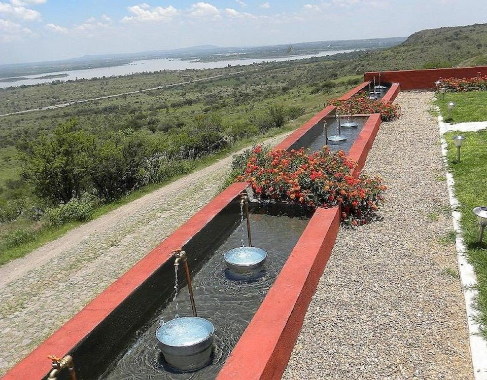 grass sky ground red mountain waterway asphalt walkway track reservoir farm machine outdoor object