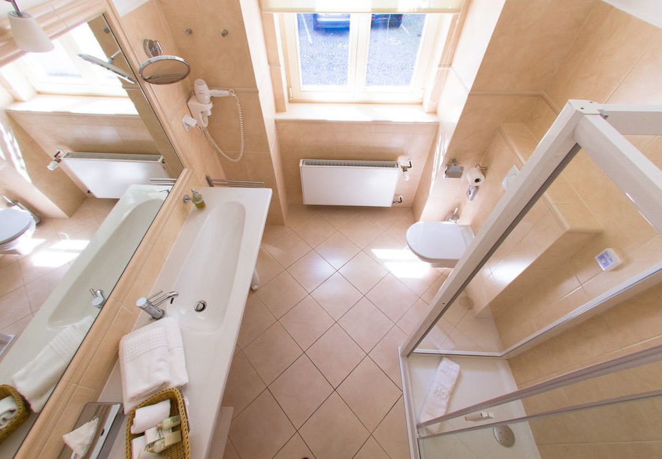 bathroom property toilet stairs flooring home vehicle yacht cottage attic bathtub tub