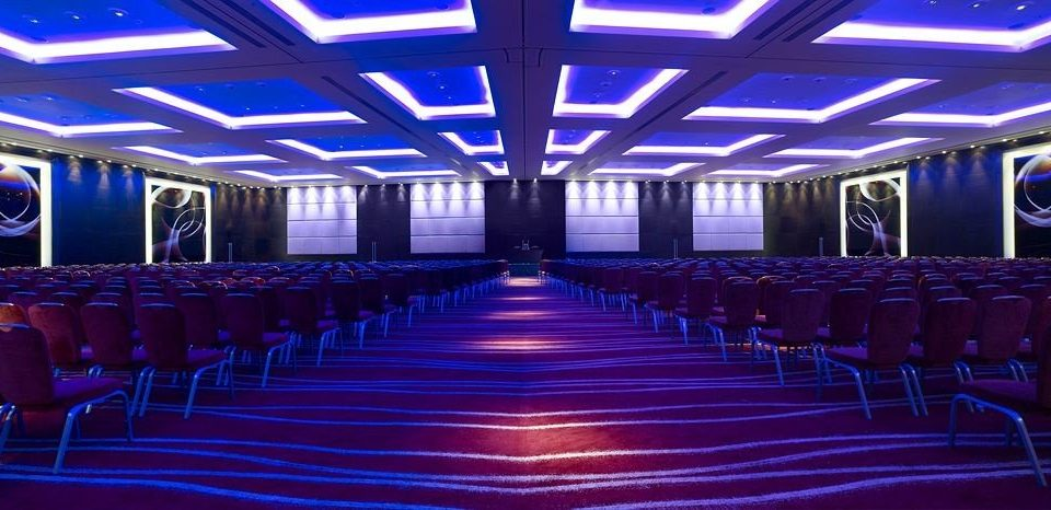 auditorium function hall chair stage conference hall convention center ballroom theatre convention audience banquet