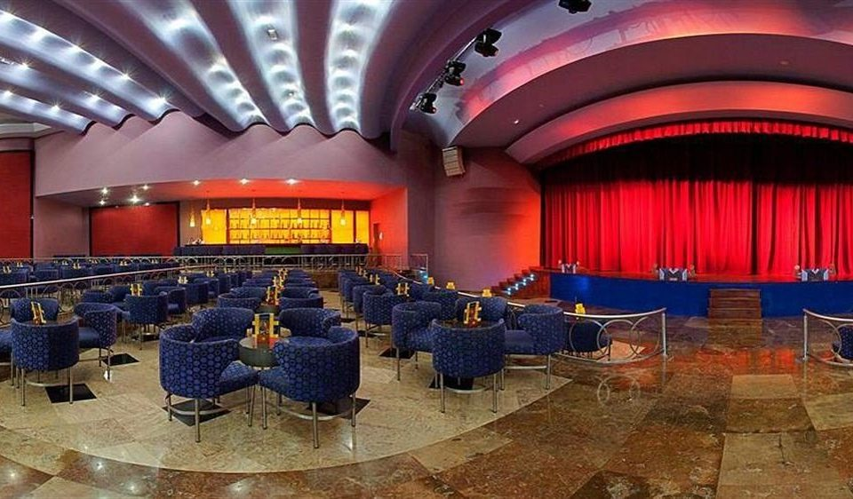auditorium chair stage function hall conference hall red convention center audience convention movie theater theatre ballroom