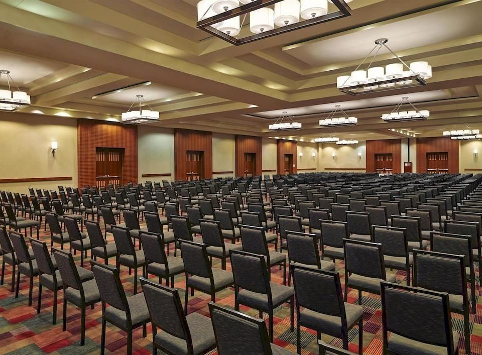auditorium chair conference hall convention center function hall audience convention lined hall line