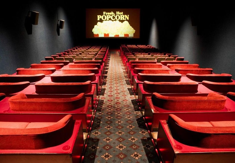 auditorium red movie theater stage theatre audience pew conference room