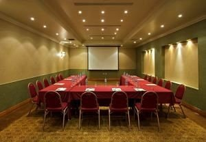 chair conference hall function hall auditorium event convention center billiard room banquet ballroom empty conference room